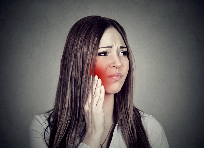 A woman needing TMJ treatment in PHOENIX, AZ