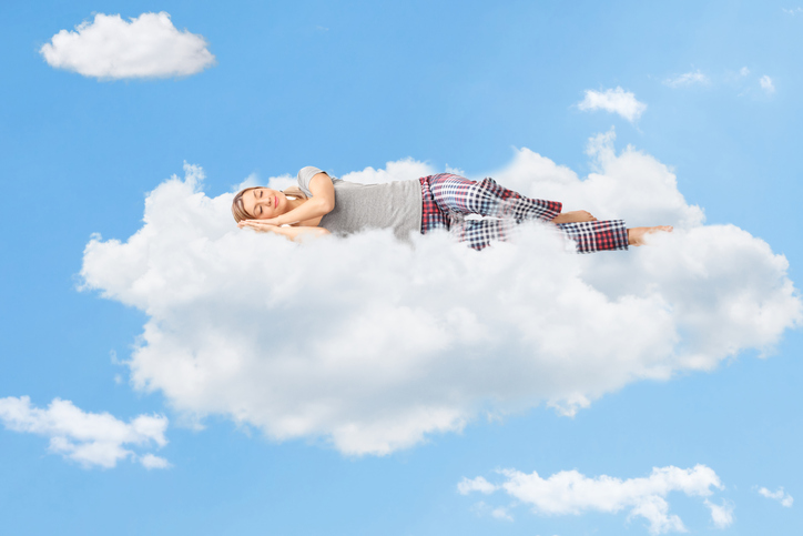 A woman sleeping on a cloud, metaphorically representing Sedation Dentistry in Phoenix Arizona
