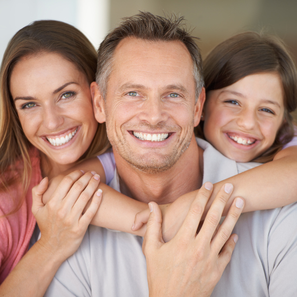 Healthy family smiling after their dental treatment at Dr. Schwei's office in Phoenix, AZ
